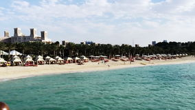 Pan shot of the Jumeira Beach, Dubai, United Arab Emirates stock video footage