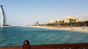 Pan shot of the Jumeira Beach and Hotels, Burj Al Arab, Dubai, United Arab Emirates stock footage