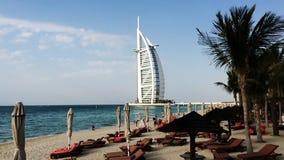 Pan shot of the Jumeira Beach and Hotels, Burj Al Arab, Dubai, United Arab Emirates stock video