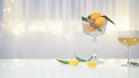 Pan shot of vases with mandarin and glasses of lemonade and champagne stock video footage