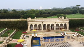 Pan shot of swimming pool area of Hotel Amar Villas, Agra, Uttar Pradesh, India stock video