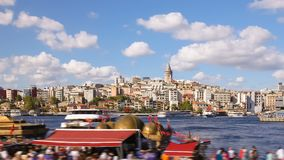 Pan shot Timelapse of people walking around famoust tourist place in Istanbul with Galata Tower view and Bosphorus. Timelapse of people walking around famoust stock video footage