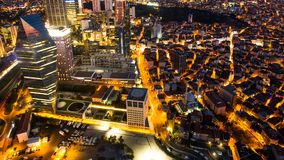 Pan shot timelapse rooftop view of Istanbul cityscape and business district at night. Pan shot timelapse rooftop view of Istanbul cityscape and business district stock footage