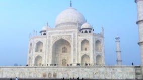 Pan shot of tourists at Taj Mahal, Agra, Uttar Pradesh, India stock video