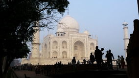 Pan shot of tourists at Taj Mahal, Agra, Uttar Pradesh, India stock footage