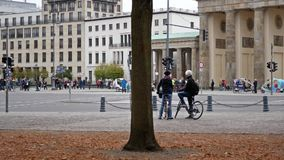Pan shot of tourists and traffic in front of Brandenburg Gate In Berlin, Germany stock video