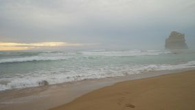 Pan shot of waves crashing on the beach at Twelve Apostles in Australia stock video