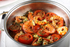 Pan with shrimp and tomato Stock Image