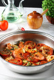Pan with shrimp and tomato Royalty Free Stock Images