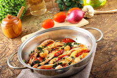 Pan with shrimp and tomatoes Royalty Free Stock Images