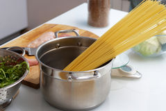 Pan with spaghetti on the table Royalty Free Stock Photography