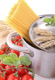 Pan with spaghetti and tomato Royalty Free Stock Photo