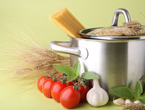 Pan with spaghetti and tomato Royalty Free Stock Images