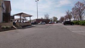 Pan in of Starbucks Coffee restaurant backed up drive thru on Robert C Daniel Parkway