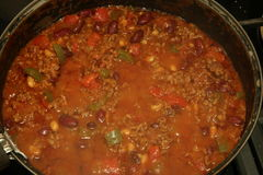 Pan of steaming  hot bubbling Chilli Con Carne Royalty Free Stock Image