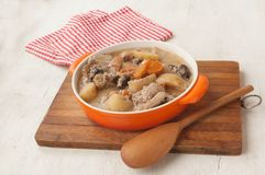 Pan with stewed rabbit in sour cream Royalty Free Stock Image