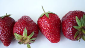 Pan Strawberries Isolated On White Background stock video footage