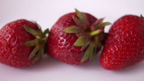 Pan Strawberries Isolated On White Background. Pan Appetizing Strawberries Isolated On White Background stock video footage