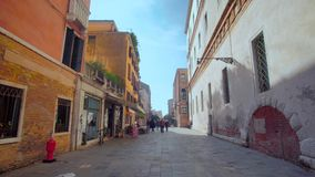 Pan through streets of Venice, Italy stock video footage