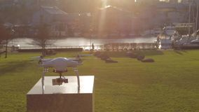 Pan sun  on white drone - park background. VANCOUVER,CANADA - CIRCA December 2014 :pan sun  on white drone - park background stock video footage
