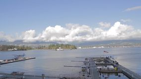 Pan - sunny day of float planes at coal harbour Vancouver. Sunny day of float planes at coal harbour Vancouver stock footage
