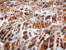 Pan of sweet rolls with frosting Stock Photo
