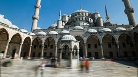 Pan timelapse of the blue mosque or sultanahmet outdoors in Istanbul in Turkey. Pan timelapse of the blue mosque or sultanahmet outdoors with moving people in stock video