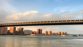 Pan of Traffic on Manhattan Bridge over the East River stock video footage