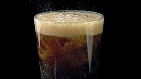 Moving Up As Coke Pours Into Glass. Pan up as coke drink is poured over ice cubes stock video