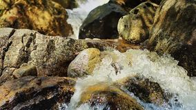 Pan Up Beautiful Rocky Stream In Afternoon stock video