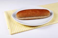 Pan vacío del bocadillo en una placa Imagen de archivo