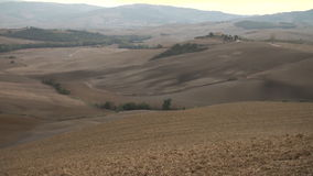 Pan of valley at dusk. Pan of The Val d'Orcia in Tuscany, Italy at dusk as the sun sets stock video