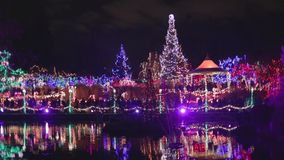 Pan - Vandusen festival of lights lake. VANCOUVER,CANADA - CIRCA December 2014 :pan - Vandusen festival of lights lake stock video
