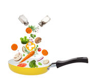 Pan with vegetables in freeze motion Stock Images