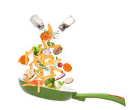 Pan with vegetables in freeze motion Stock Image