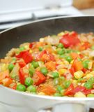 Pan with vegetables in kitchen Royalty Free Stock Photography