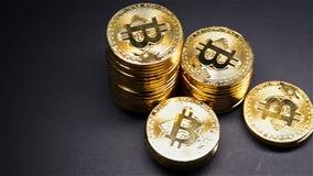 Pan view bitcoins on dark