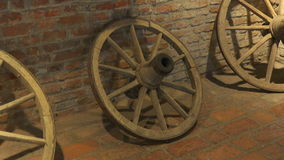 Pan view over old wooden cart wheels. Old room stock footage