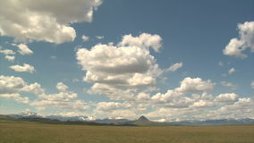 Pan of wide blue skies and distant mountains. Video of pan of wide blue skies and distant mountains stock video footage