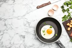 Free Pan With Fried Sunny Side Up Egg Served On Table Royalty Free Stock Image - 130299316