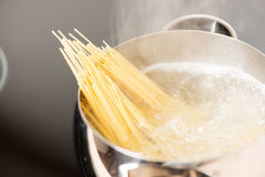 Pan With Spaghetti Cooking In Boiling Water Stock Photo