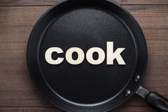 Pan with word cook. Big pan on the table with word cook Royalty Free Stock Photo