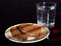 Pan y agua Imágenes de archivo libres de regalías