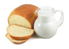 Pan y leche aislados Imágenes de archivo libres de regalías