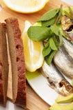 Pan y pescados Fotos de archivo libres de regalías