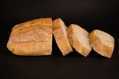 Pan y rebanadas del pan Foto de archivo libre de regalías