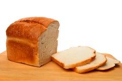 Pan y rebanadas del pan Fotografía de archivo libre de regalías