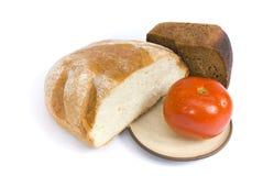 Pan y tomate Imágenes de archivo libres de regalías