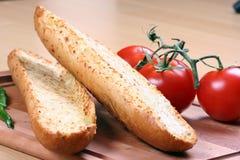 Pan y tomates de ajo Imagen de archivo libre de regalías