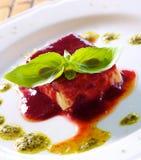 Panacotta. Classic italian dessert with raspberry sauce Royalty Free Stock Photography